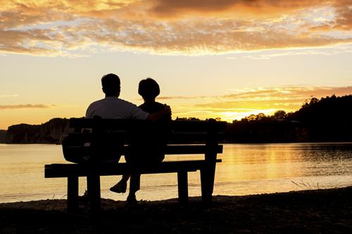 Happy couple enjoying the sunset